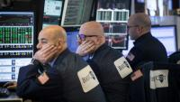 Traders au New York Stock Exchange le 12 février 2018
