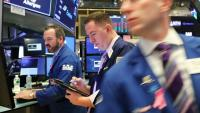Des traders à la bourse de New York le 15 octobre 2018