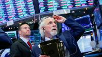 Wall Street grimpe, misant sur la recovery